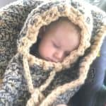 Sleeping in car seat with crochet poncho on