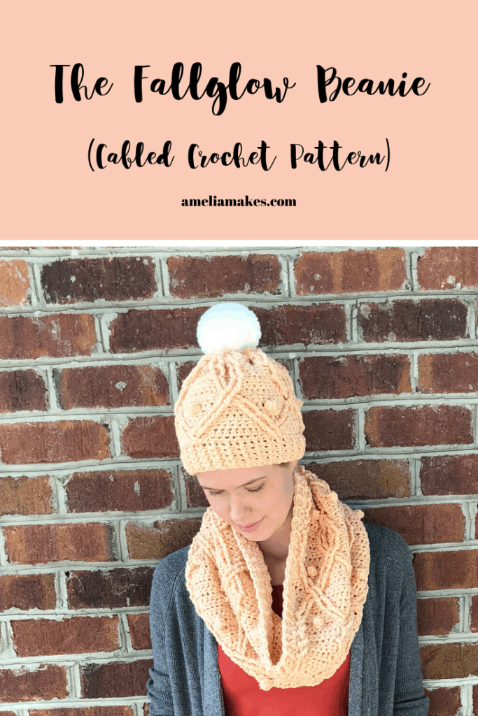 This crochete beanie features cables and bobbles