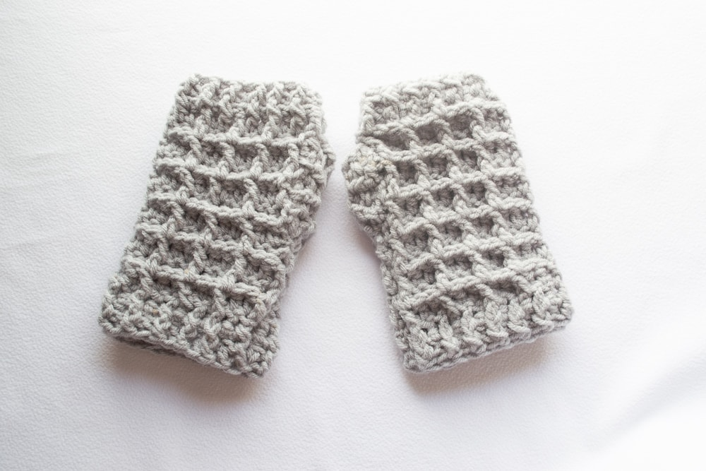 set of crochet fingerless gloves with pattern in the post