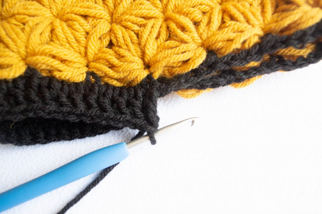 Closeup of adding ribbing to a beanie
