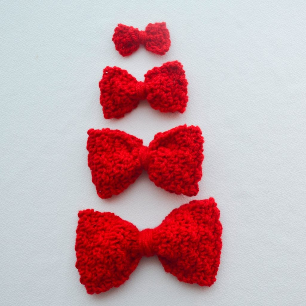 Image of four different crochet bows laid on a flat surface