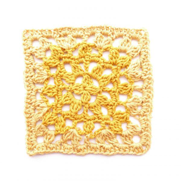 Flat lay image of a lacy crochet square