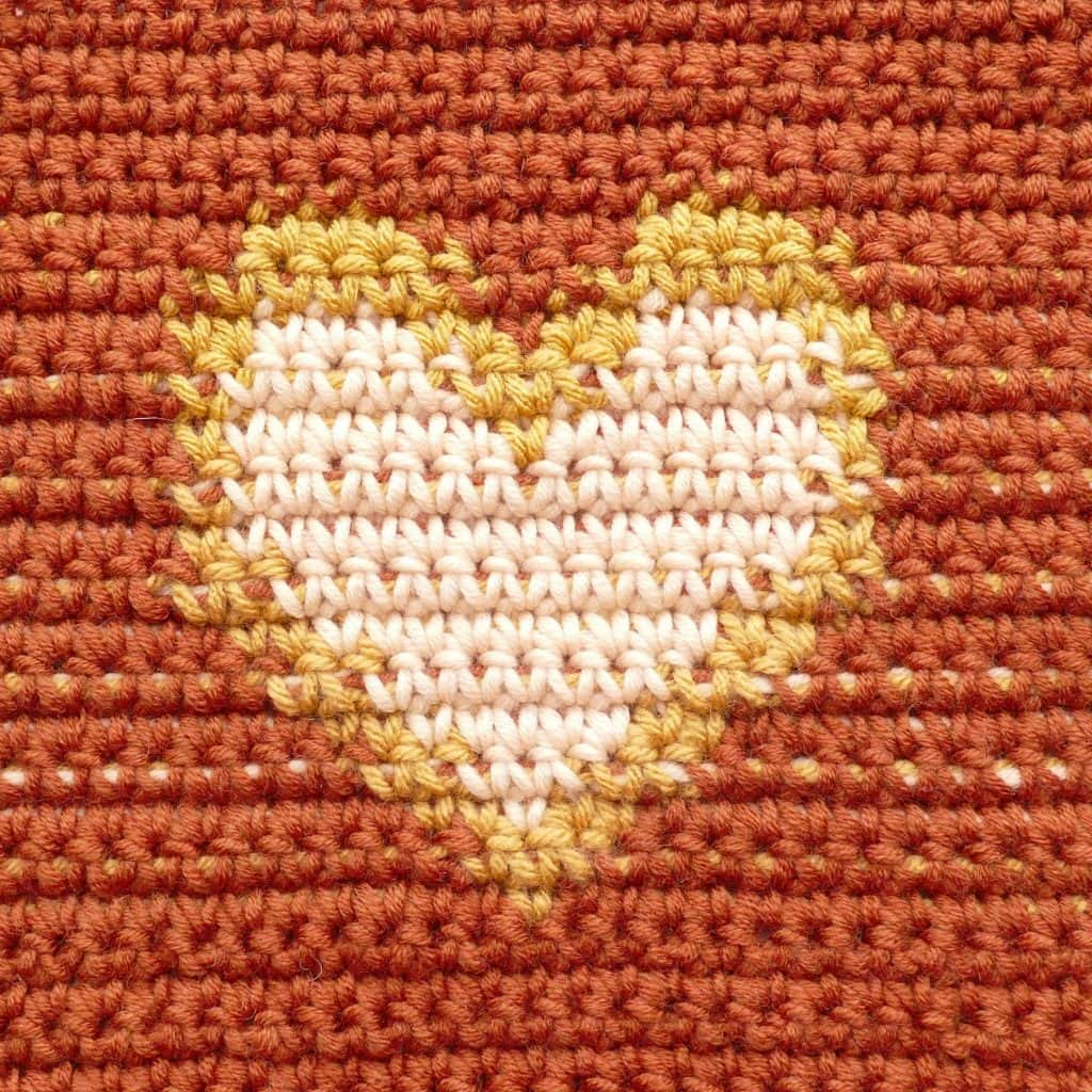 closeup of tapestry heart square