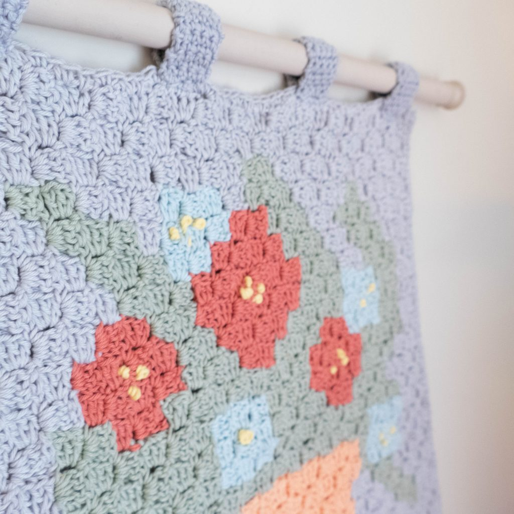 featured image showing the floral wall hanging on a wall